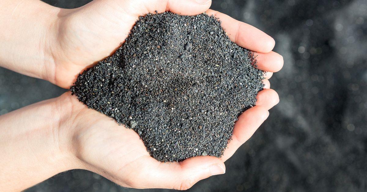 holding black sand